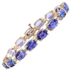 29.50 Carat Tanzanite 18 Karat Yellow Gold Diamond Bracelet
