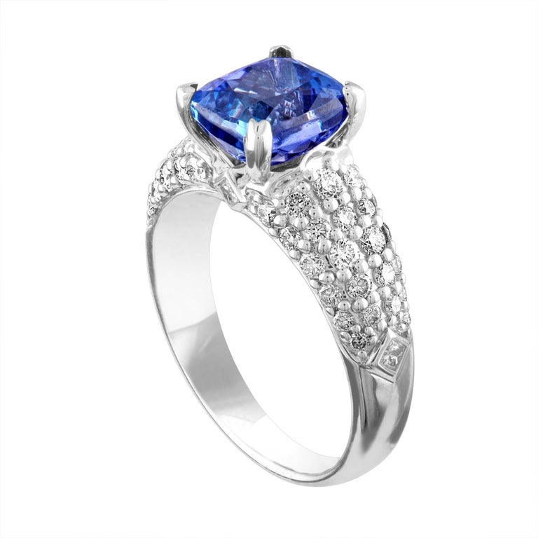 Beautiful Pave Ring The ring is 18K White Gold The Center Stone is a Cushion Cut Tanzanite 2.97 Carats There are 0.99 Carats in Diamonds F/G VS/SI The ring is a size 6.50, sizable The ring weighs 5.3 grams