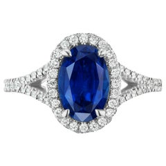 2.97 Carat Oval Blue Sapphire and Diamond 14 Karat Halo