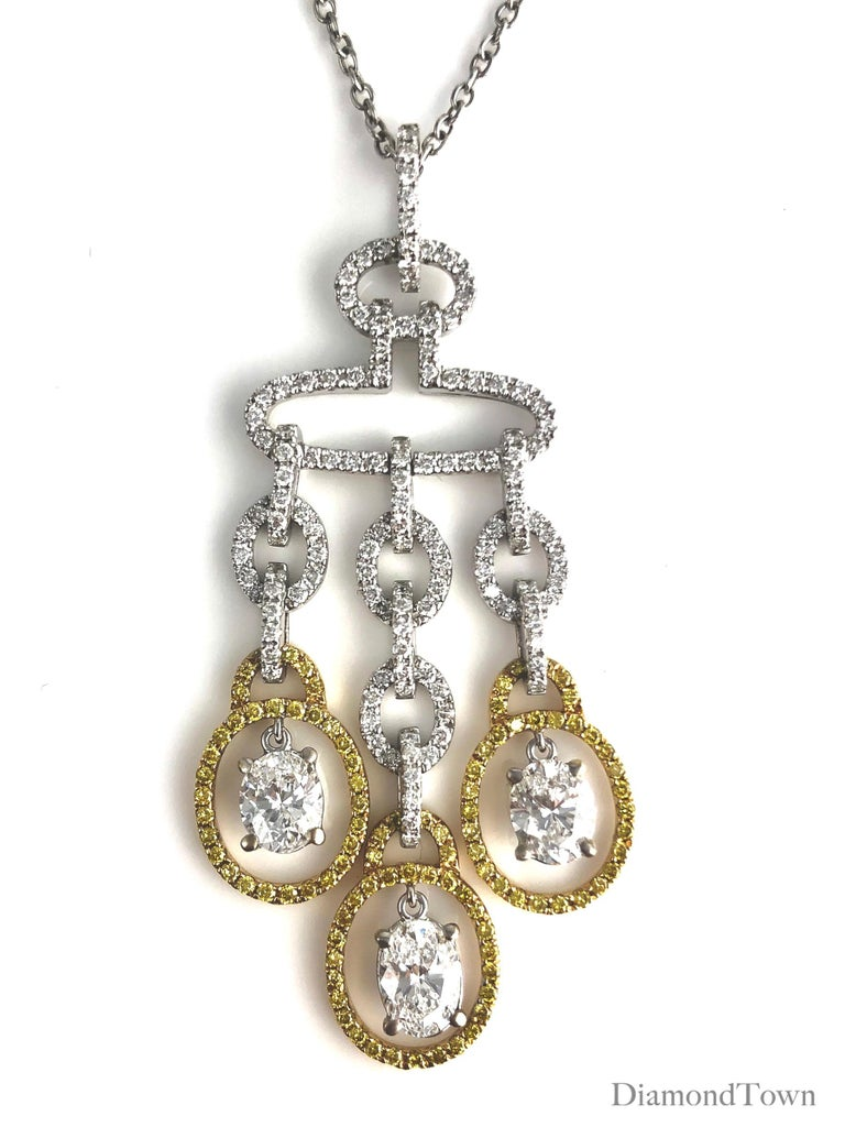 This beautiful drop diamond pendant features three pear-shape diamonds (total weight 1.63 carats) in a playful chandelier shape. Additional round yellow and white diamonds bring the overall diamond weight to 2.98 carats. The pendant is set in 18k