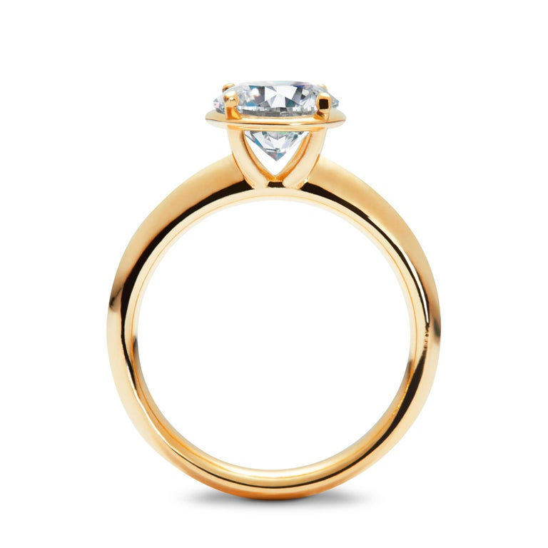 The No.1 Solitaire ring is designed to maximise the brilliance and luminosity of the diamond.  Our distinctive halo is carefully engineered to elevate the diamond, emphasizing its size while strengthening and protecting the stone's integrity. The