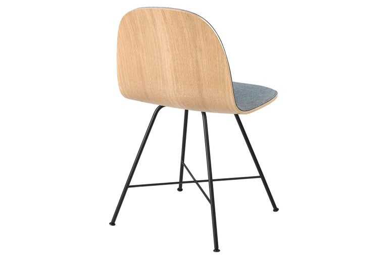 The GUBI 2D Chair is a series of light dining chairs made from laminated veneer with options for front upholstery in a wide range of fabrics and leathers, suitable for both private and public spaces. Being an extension to the classic GUBI 3D Chair,