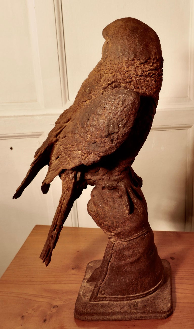 Late 19th Century Weathered Cast Iron Statue of a Falcon on a Gloved Hand For Sale