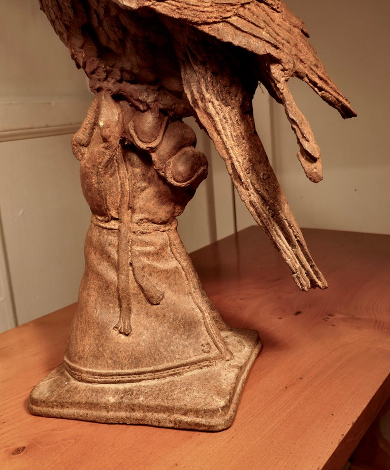 Weathered Cast Iron Statue of a Falcon on a Gloved Hand For Sale 1