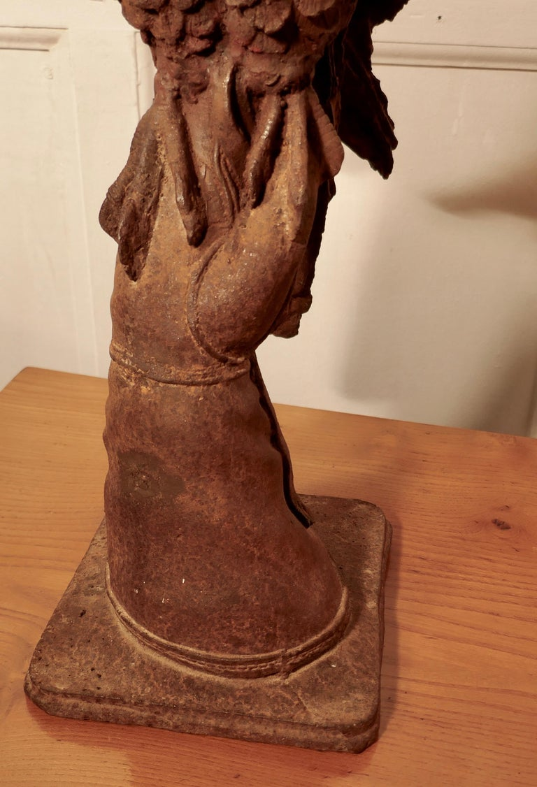 Weathered Cast Iron Statue of a Falcon on a Gloved Hand For Sale 4