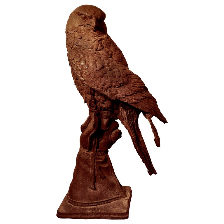 Weathered Cast Iron Statue of a Falcon on a Gloved Hand For Sale