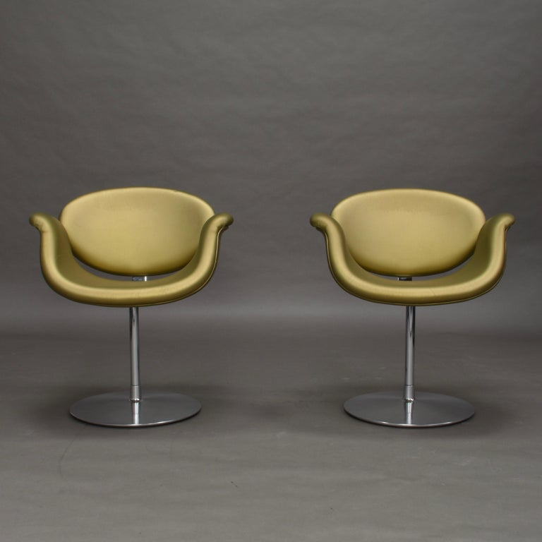 Pair of limited editionLittle Tulip swivel chairs by Pierre Paulin for Artifort, Netherlands, 1965.  The chairs are produced as a limited edition in gold faux leather. The swivel base is made of chromed metal. The faux leather has some age