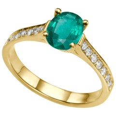3/4 Carat 14 Karat Yellow Gold Oval Emerald Engagement Ring
