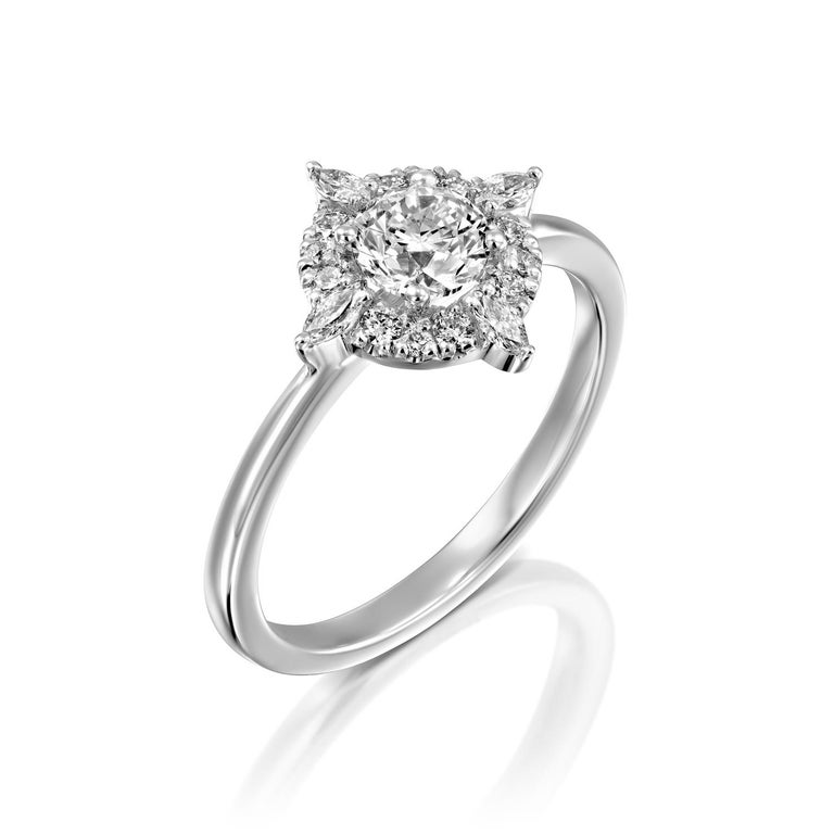 Unique and special Victorian style GIA certified diamond engagement ring. Ring features a 3/4 carat round cut 100% eye clean natural diamond of F-G color and VS2-SI1 clarity and it is surrounded by smaller natural round diamonds approx. 0.25 total