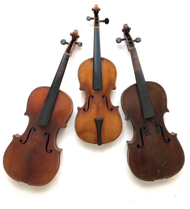 3 antique violins. These are decorative for display or for parts only. Cracks and missing pieces. They range in size from 20.5