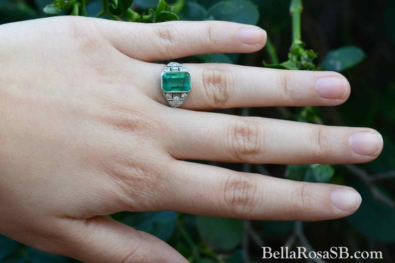 We are pleased to offer this certified Colombian emerald Art Deco Engagement ring. An enchanting green which has inspired generations of collectors to seek Colombian Emeralds for their verdant color. A fine, 3.20 carat gem is the heart of this
