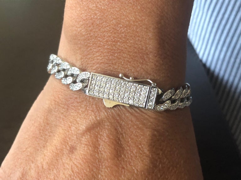 Cuban Diamond bracelet set in 14K white gold. The bracelet is manufactured in Italy. The total carat weight of the bracelet is 3.04 carats. The color of the stones are G-H, the clarity is SI1-SI2. The bracelet is available in yellow gold.