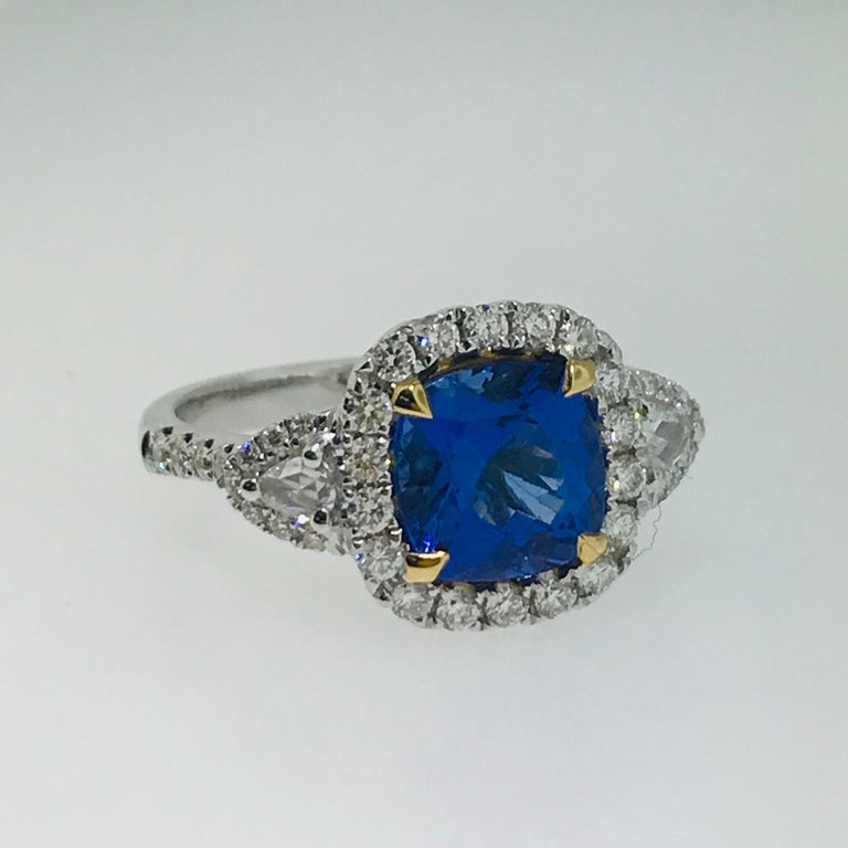 3 Carat Cushion Tanzanite And Diamond Halo 18 Karat White Gold 3 Stone Ring