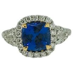 3 Carat Cushion Tanzanite and Diamond Halo 18 Karat White Gold 3-Stone Ring