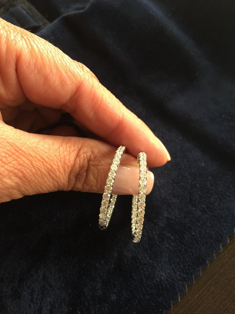 Diamond hoops 1.25 inch diameter inside out. Color and Clarity of the stones are G-H, SI2. Total carat weight is 2.76. Stones are excellent cut. Set in 14K white gold.