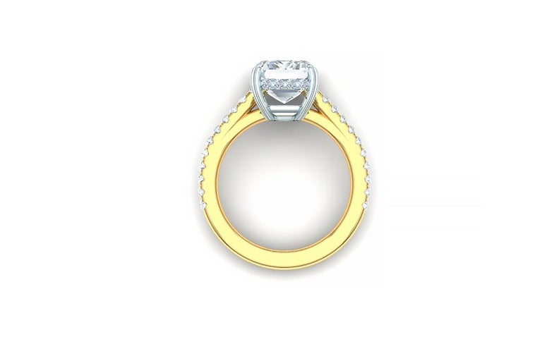 This classic and beautiful diamond ring has a 2 carat GIA certified G-VS2 Emerald cut diamond centered and over one carat of round brilliant diamond set in the shank of the ring. This diamond ring is cast from both platinum and 18k yellow gold. The