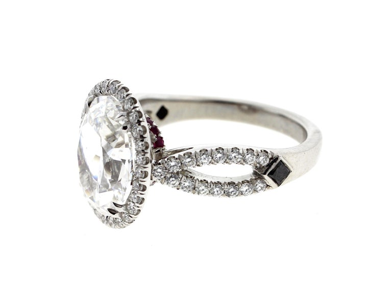 This 3 carat oval diamond engagement ring is crafted in platinum and contains an Oval Cut Diamond (3.01 Carat, D Color, SI1 Clarity, GIA) center diamond surrounded by 58 Round Brilliant Diamonds (0.48 total carat weight, F Color, VS Clarity).  The