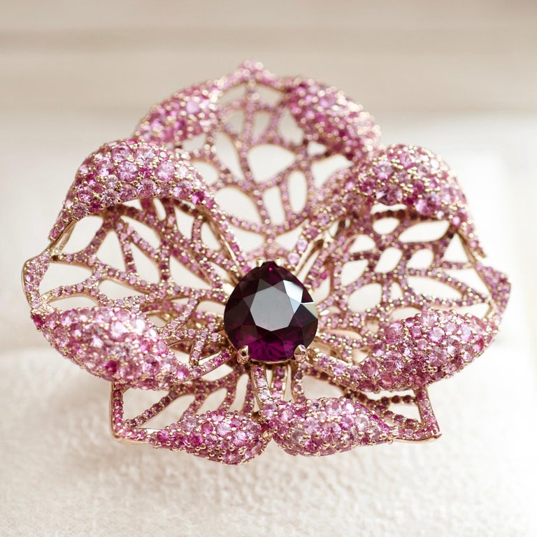 This cocktail ring belongs to our High Jewelry Collection. It is one of a kind rose gold ring with noble spinel set together with rose pave.  It looks like a real flower and it instantly attracts the attention.  The main idea of the design is to