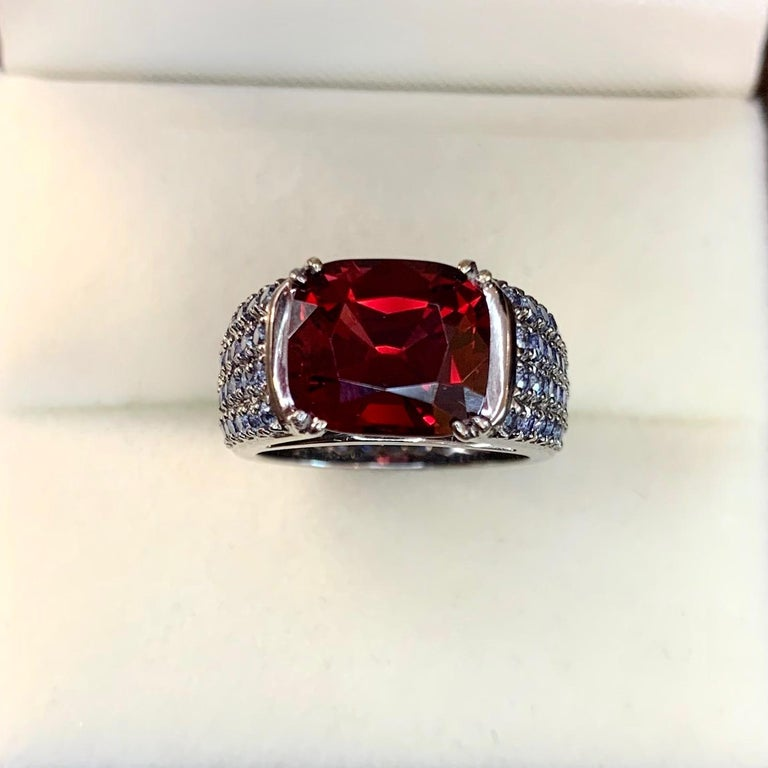 It is always interesting to make jewelry with beautiful red stones. That is why we chose 18 karat gold with black rhodium to enhance the red color of quite big red Burmese spinel (around 3 carat) and make very stylish and elegant frame with