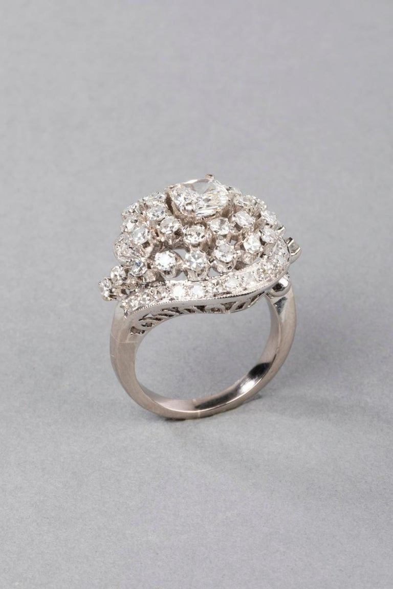 Very beautiful diamond ring, made in France circa 1940. Mounted in white gold and Beautiful diamonds.  French mark for gold 18 (the owl). The ring sparkles a lot, it has a lot of presence. The design is cocktail / twister