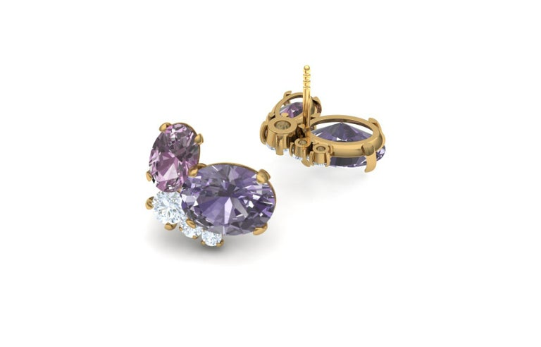 A gorgeous pastel play on an underrated and now very popular gemstone in the Spinel.  Spinels have long been misidentified as sapphire or even rubies.  Spinels grace some of the most historic jewels including the queens crown.  This pair of cluster
