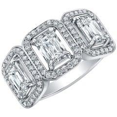 3 Emerald Cut Diamonds with Single Halo Pavé Ring
