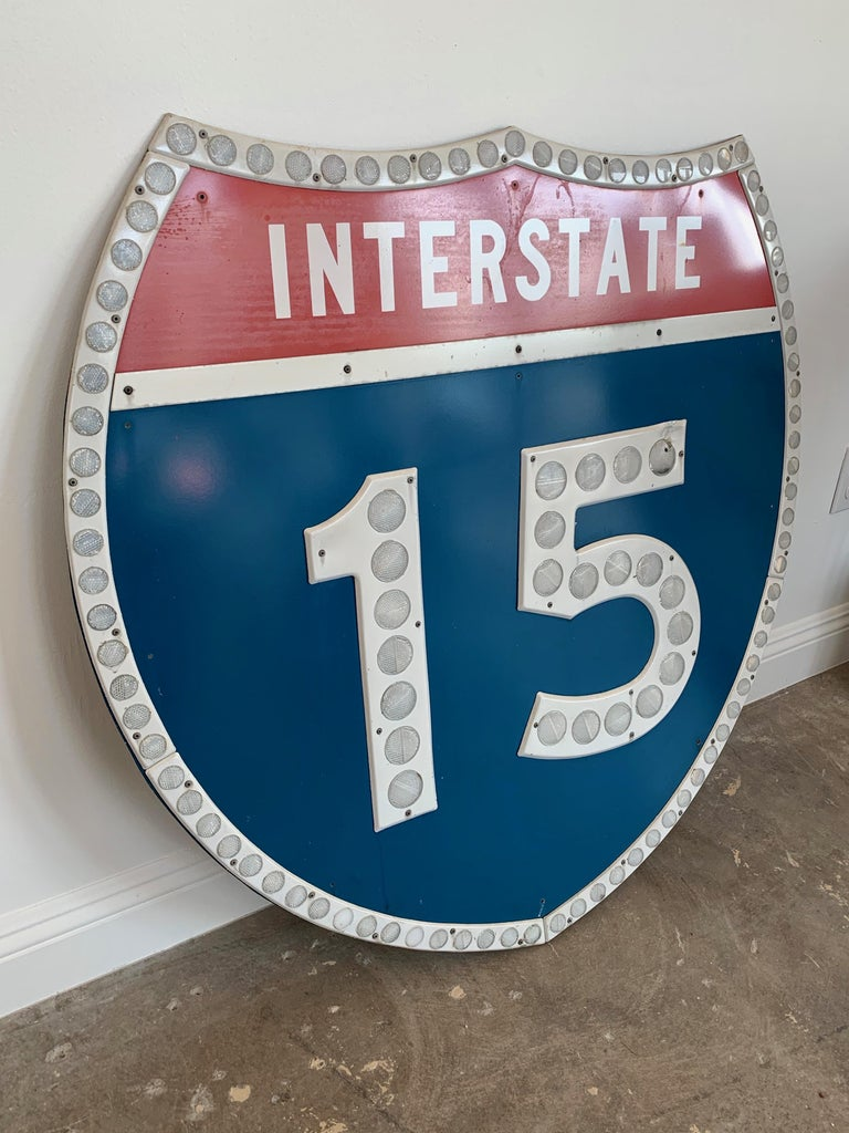Vintage Los Angeles freeway shield from the 15 freeway in Los Angeles. Interstate 15 runs from from the Mexican border, through 5 states to the Canadian border. This large freeway shield is stamped CA - 82. Made in 1982, and hung for 37 years before