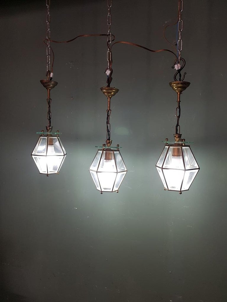 Set of 3 identical old French brass frame pendants with facet cut glass and they have a bayonet fitting, all 3 are in good condition with light wear consistent by age, and the electricity has been replaced by us. Originating from the mid of the 20th