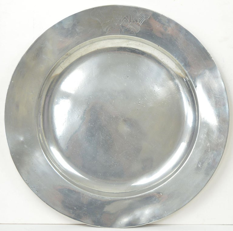 Wonderful highly polished chargers. A lovely distressed industrial look.  The pewter has been polished to its original shine. It was known as the Poor Man's Silver.  One of them has a superb armorial on the edge.  The great thing about