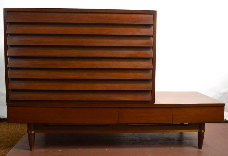Nice Merton Gershon designed cabinetry produced by American of Martinsville. This group includes a louvered drawer chest (18.5 D x 36 W x 22.5 H) which sits on a bench, coffee table (each bench 18.75 D x 54.5 W x 12.5 H) two benches included. All