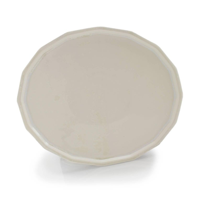 Place setting Our place setting features the essentials from our sleek and timeless dinnerware collection. The solid-cast dinner plate, soup bowl and side plate are durable, beautiful, and have the loveliest minimal stack. Mix and match or get a