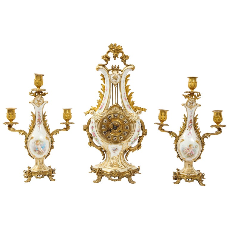 3-Piece Sevres Porcelain and Dore Bronze Mnt. Clock and Candelabra Garniture For Sale