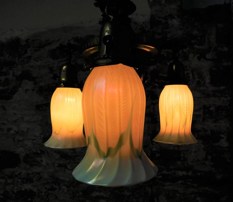 Art Nouveau light fixture with three matching Quezal pulled feather  lamp shades.