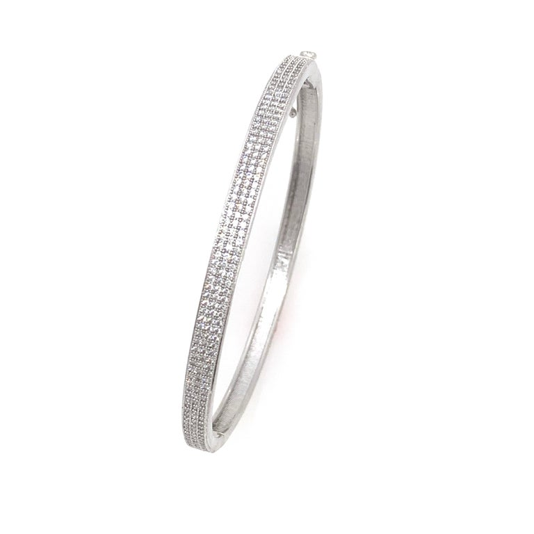 3-row Micropave Simulated Diamond Sterling Silver Bangle Bracelet.  This chic and modern bracelet features over 200 pcs of round simulated diamond, micro set on platinum rhodium plated sterling silver, push clasp closure and '8' safety lock. The