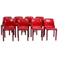 3 Selene Stacking Chairs by Vico Magistretti for Artemide in Dark Red
