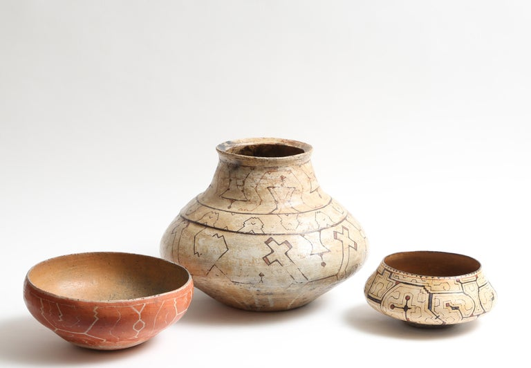 Wonderful midcentury Peruvian tribal pots. The largest being 14