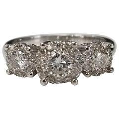 3-Stone 14 Karat Diamond Halo Ring