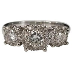 3-Stone 14 Karat Diamond Halo Ring Total Weight 1.14 Carat