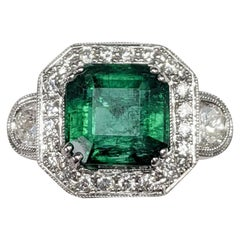 3-Stone Emerald Cut White Diamond Ring