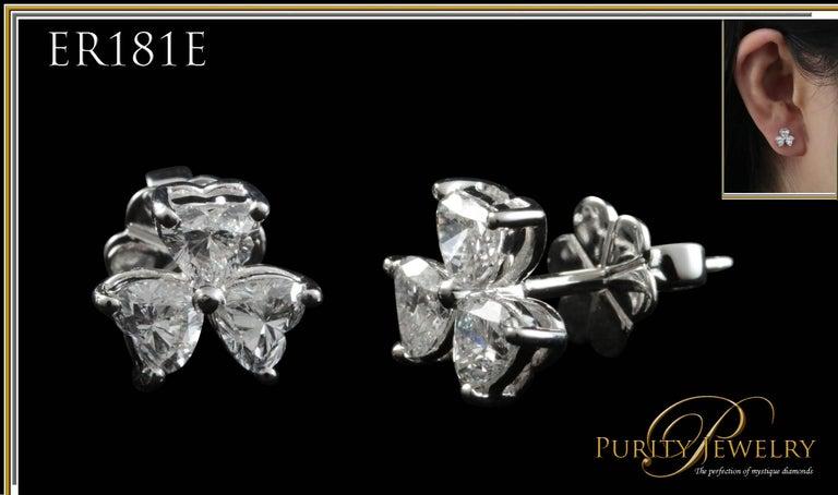 Modern 3 Stone Heart Shaped Diamond Stud Earrings Set in 18Kt Gold For Sale