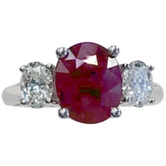 3-Stone Oval Ruby and White Diamond Fashion Ring