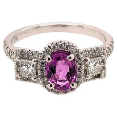 3-Stone Pink Sapphire Ring with White Cushion Diamonds and Diamond on the Shanks
