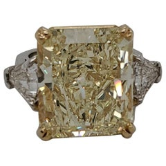3-Stone Ring with GIA Certified 16.95 Carat Fancy Yellow SI1 Center Diamond