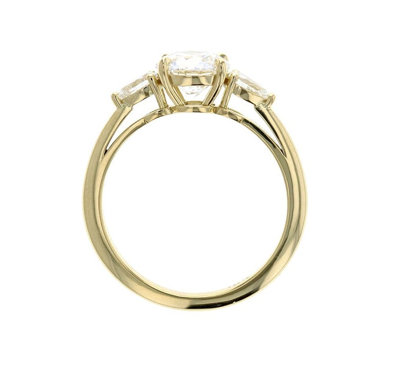 Round Cut 3-Stone Round Diamond Engagement Ring with Pear Shaped Side Stones Yellow Gold For Sale