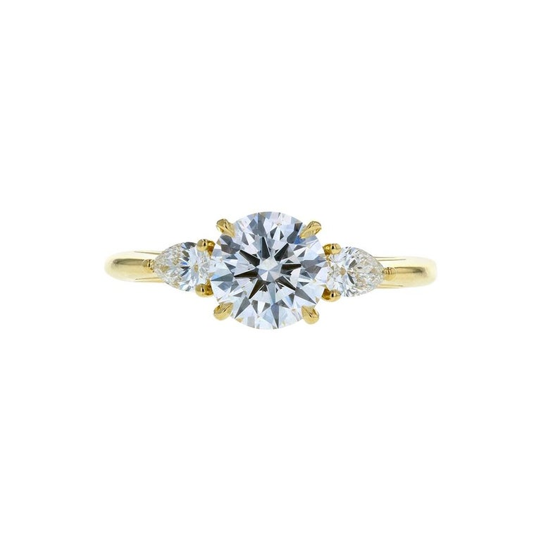 3-Stone Round Diamond Engagement Ring with Pear Shaped Side Stones Yellow Gold For Sale