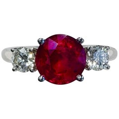 3 Stone Round Ruby Fashion Ring with White Diamonds