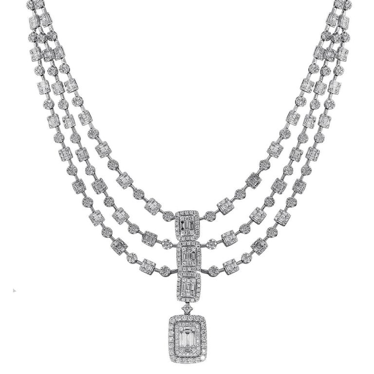 Material: 18k White Gold Diamond Details: A total of 803 round brilliant diamonds that are approximately 10.50ctw A total of 435 baguette cut diamonds that are approximately 9.29ctw Diamonds are G/H in color and VS in clarity. Measurements: Necklace