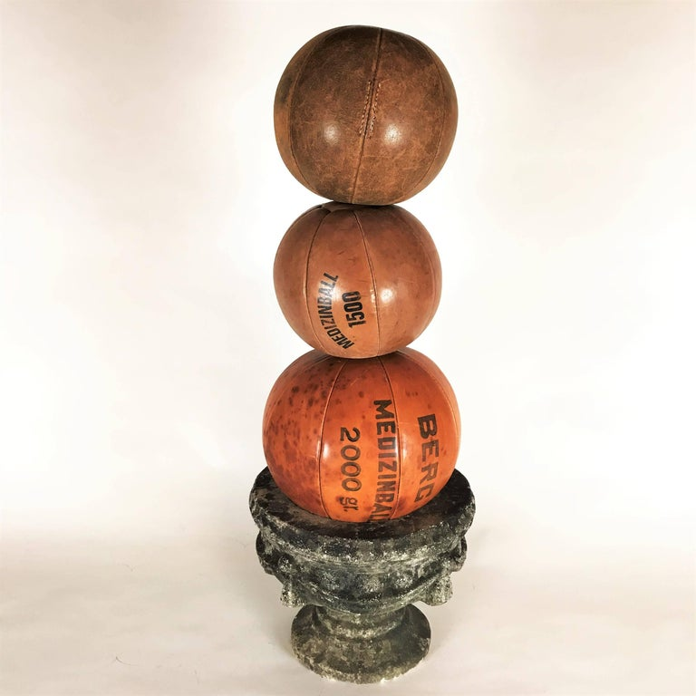 The medicine balls are part of a big collection from the 1920s-1930s, the time of the first gym enthusiasts in Germany.