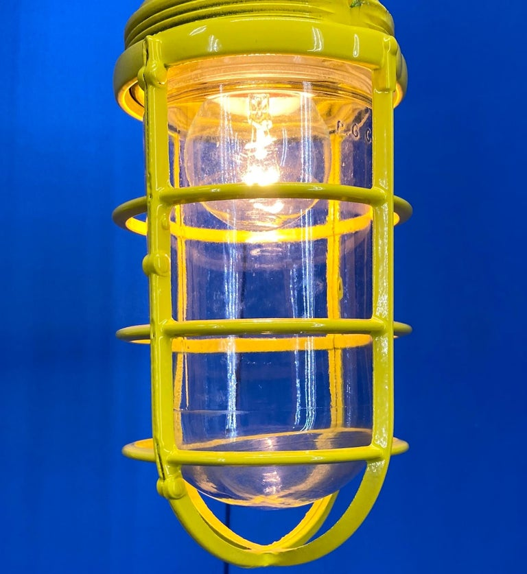 Cast 3 Yellow Salvaged Industrial Three-Light Blast Proof Ceiling Fixtures For Sale