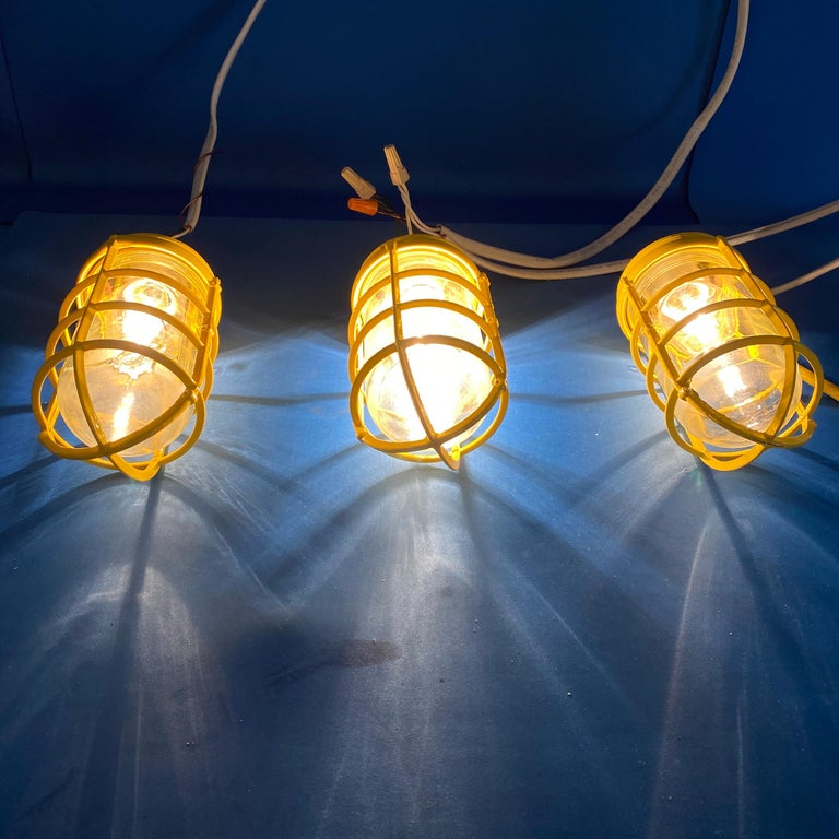20th Century 3 Yellow Salvaged Industrial Three-Light Blast Proof Ceiling Fixtures For Sale